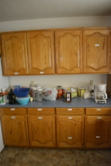 Lots of cabinets in the kitchen, all labeled for your convenience.