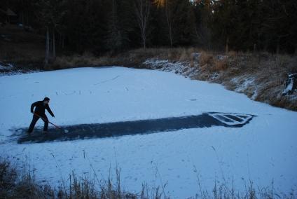 Jonathan playing shuffleboard on ice (9)