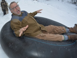 Me enjoying a tube run just outside the house in the winter.