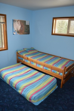 The trundle bed in the boys room.