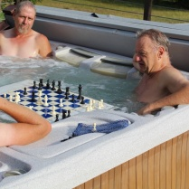 "Our featured ""floating chessboard"" gives you yet another way to enjoy our hot tub."